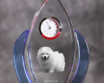 Samoyed- crystal clock in the shape of a wings with the image of a pure-bred dog.