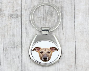 A key pendant with a Whippet dog. A new collection with the geometric dog . Dog keyring for dog lovers