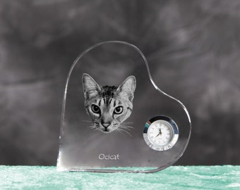 Ocicat- crystal clock in the shape of a heart with the image of a pure-bred cat.