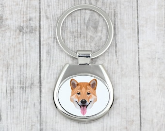 A key pendant with a  Shiba Inu dog. A new collection with the geometric dog . Dog keyring for dog lovers