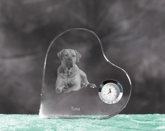Tosa- crystal clock in the shape of a heart with the image of a pure-bred dog.
