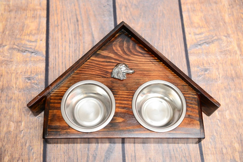 A dog\u2019s bowls with a relief from ARTDOG collection Collie