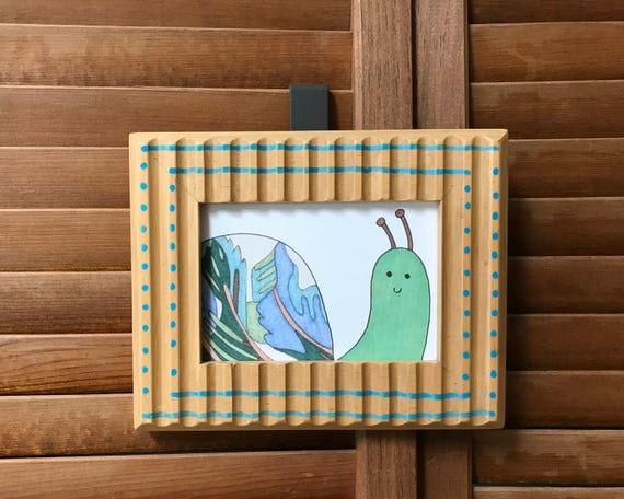Repurposed Frame with Snail Illustration