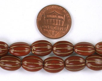 Brown opaque w/ Gold decor 12 x 9 x 4mm flat oval beads. Set of 12 or 25.