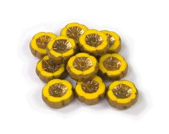 Yellow opaque w/ Bronze medium 12mm Hawaiian hibiscus flower bead. Set of 6 or 12.