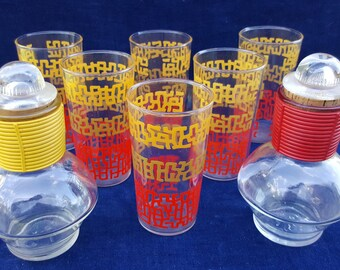 lot of yellow and red vintage glassware and glasbake carafes