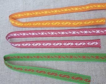 Ribbon with Latvian traditional ethnographic Zalktis signs yellow orange