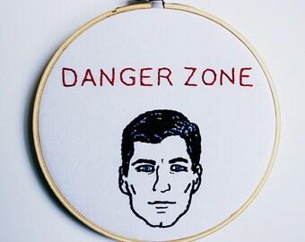 Danger Zone! Archer Quote Hand Embroidery Hoop Fan Art. TV Show Cartoon Artwork