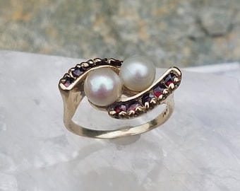 Vintage 14k garnet and pearl ring, estate 14k yellow gold bypass style pearl and garnet ring.