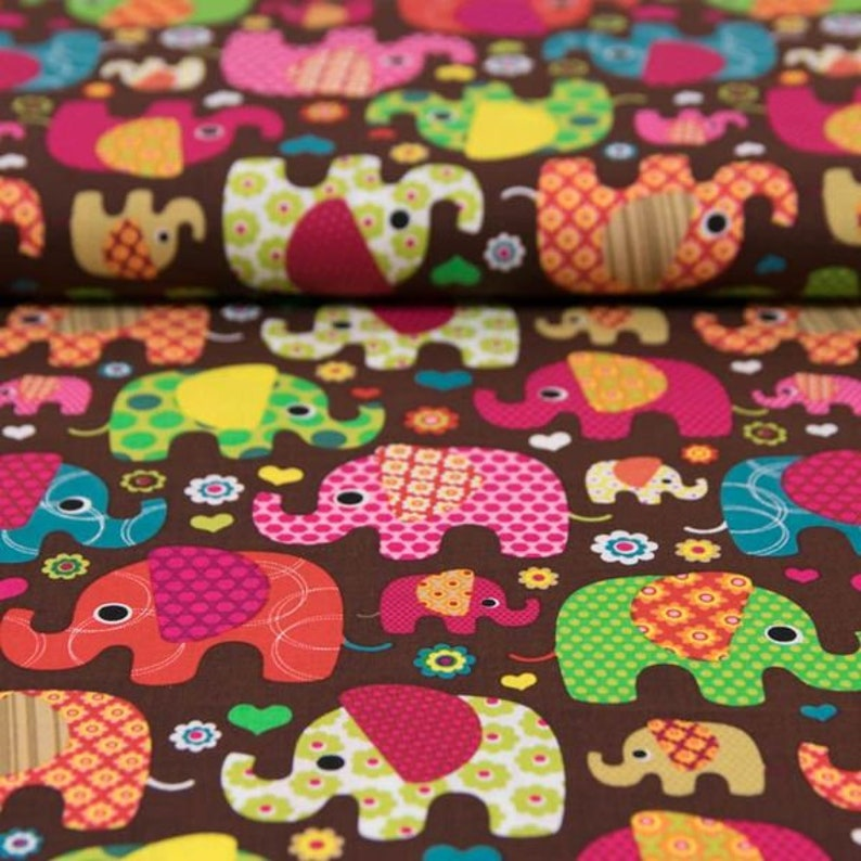 9.98 EUR/meter cotton fabric brown colorful elephants image 0
