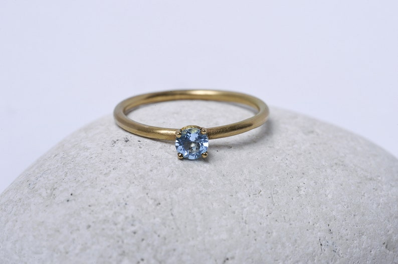 Gold engagement ring set with a blue Topaz image 0
