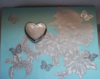 Liz Claiborne silver metal and faux mother of pearl hear shaped brooch greeting card. marked LC