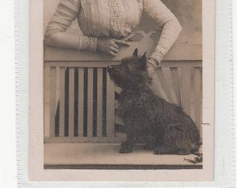 RPPC Postcard,Woman Dressed in Edwardian Style Petting Scottish Sccottie Terrier Dog