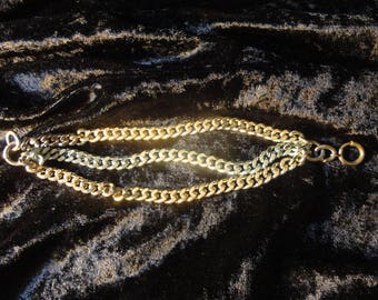 Three separate curb link chains 2 gold and 1 silver plated chains bracelet
