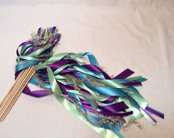 200 ribbon wands rosy mauve and off white with gold frayed and gold bells send off idea