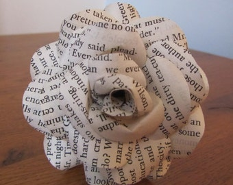 Handmade paper rose made from vintage book pages.