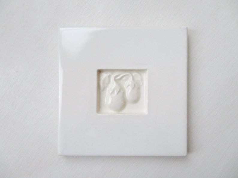 minimalist white kitchen decor white tile trivet with eggplants ceramic hot pad Pull Cart Tile vintage 90s