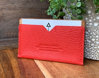 Credit card holder made of dark red leather with beige interior. Smallest wallet ever.