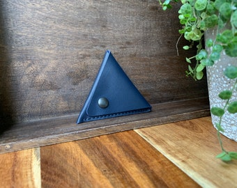 Leather triangle coin purse made of navy blue leather.