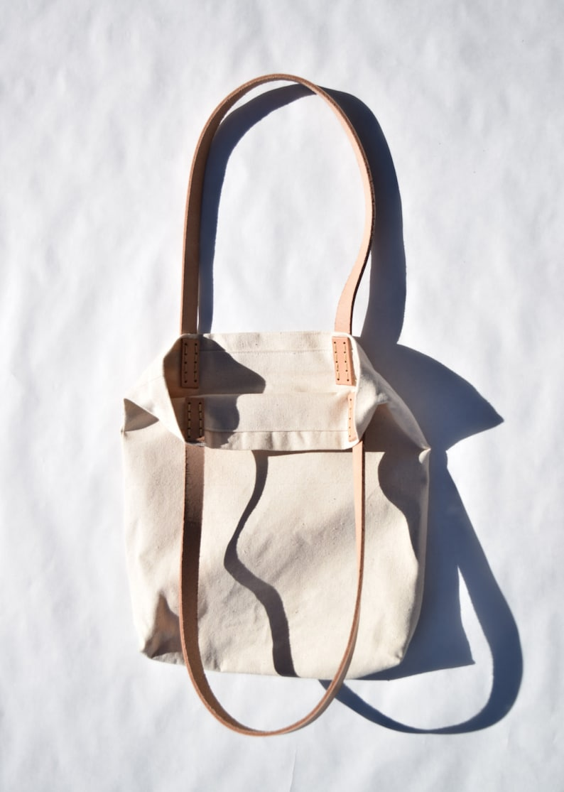 Minimalist canvas bag with hand woven fabric patch leather straps tote purse colorful abstract weaving