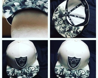 Oakland Raiders Authentic New Era Snapback or Fitted Cap with Villians Image on Top and Bottom