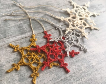 Crochet Christmas tree decor. Snowflake tree decorations. Crochet snowflakes in different colours.
