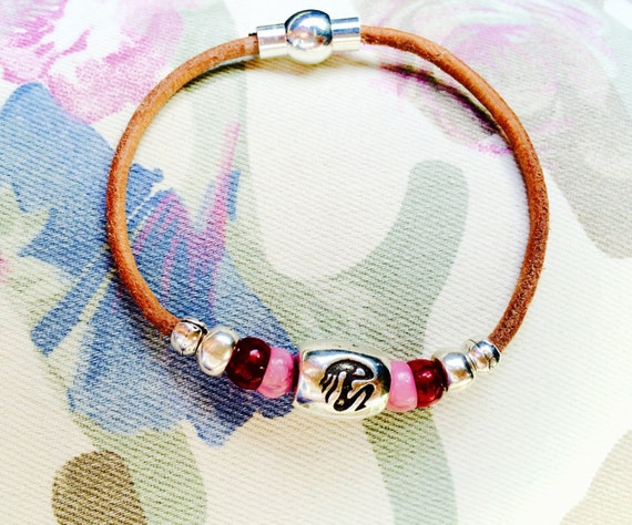 Leather bracelet with Zodiac beads