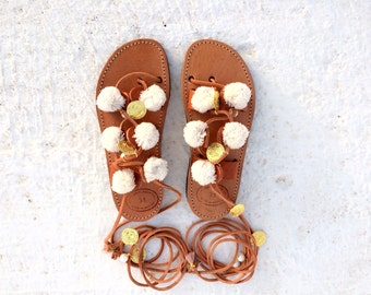 white pom pom /handmade gladietor sandals/greek sandals/white perla and gold coins/baby and girl shoes/charms kids/boho sandals/baby gift