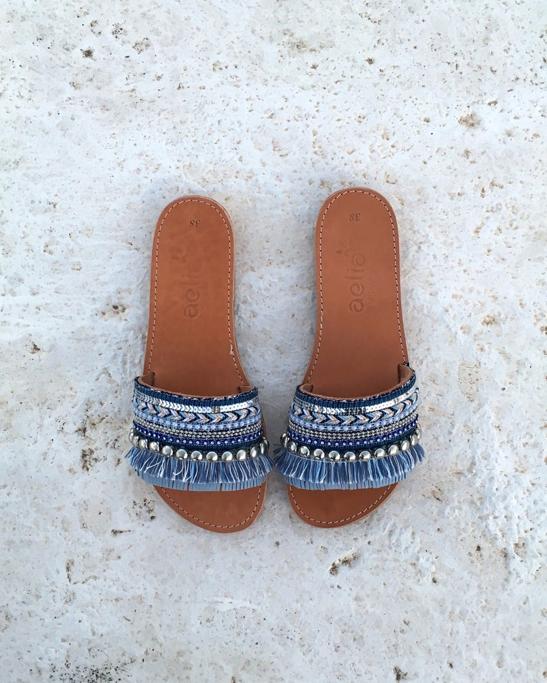 44a34ee1197d76 Woman leather sandals with blue decorate   aelia greek