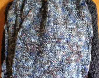 Mixed blue with red speckles scarf.  Bulky water like texture. Made from  Deluxe Heirloom Tweed yarn.
