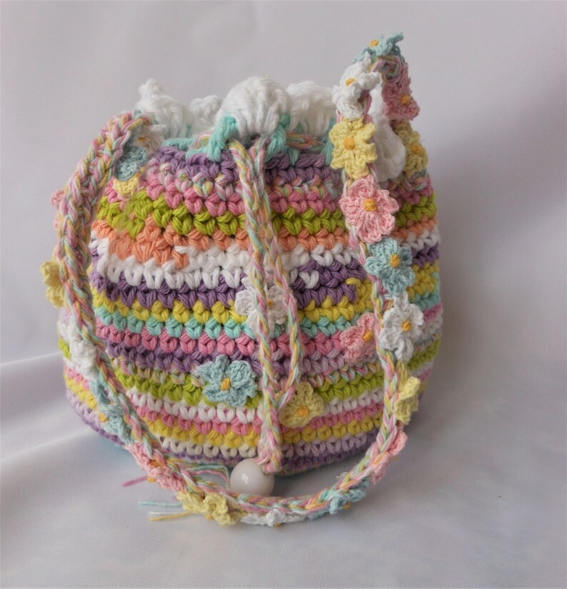 crochet drawstring little girl bag over the shoulder toddler image 0