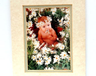 Anne Geddes Print of Baby in a Field of Daisies