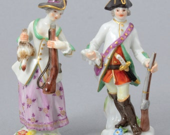 A Pair Of Miniature Meissen Porcelain Figures In The Form Of Hunters, 1956 Blue Crossed Swords Mark