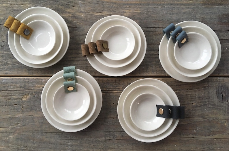 Porcelain and leather trinket dishes