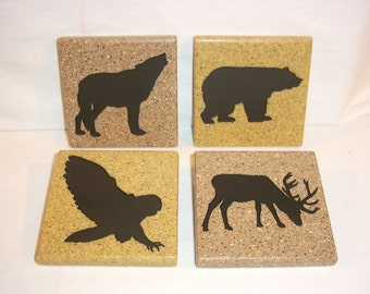 North American Wildlife themed CNC carved solid surface, acrylic coasters.  Set of four.