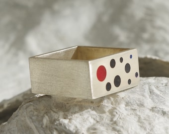 Sterling square ring with black points and a red one. Modern unisex ring.