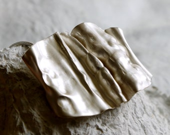 A sterling silver fold formed necklace