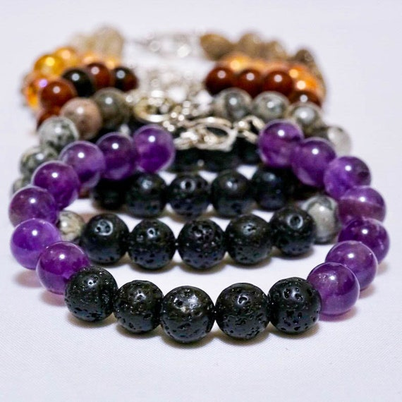 Aromatherapy bracelet with lave stone, natural stones, and 1mm bottle of oil blend