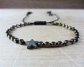 Woman bracelet with star,...