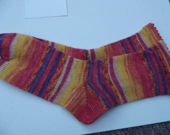 Hand Cranked and hand finished socks in sunset colours.
