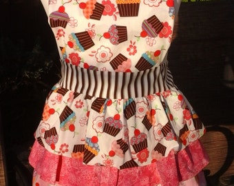 Ruffled cupcake apron in pinks and browns.