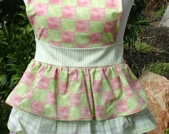 Pink & green checkerboard ruffled apron.
