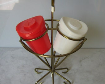 Vintage Atomic era Salt and Pepper Shakers with Brass Caddy