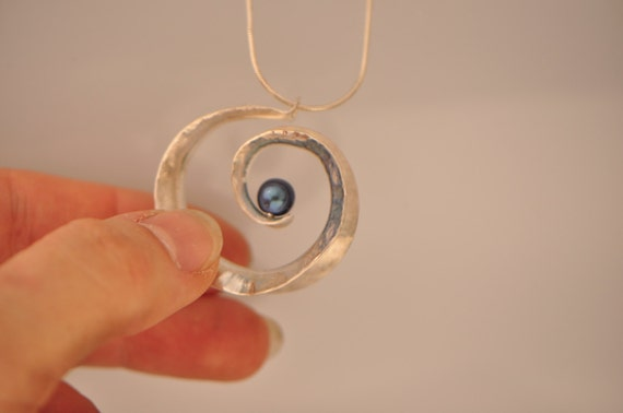 Anticlastic three-dimensional spiral pendant in sterling silver with white freshwater pearl