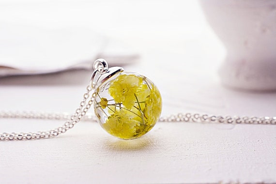 Real flower necklace pressed yellow flower resin glass globe etsy image 0 mightylinksfo