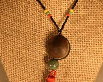 Tassle, Rasta Beads and Donkey Eye GOOD LUCK Seed.