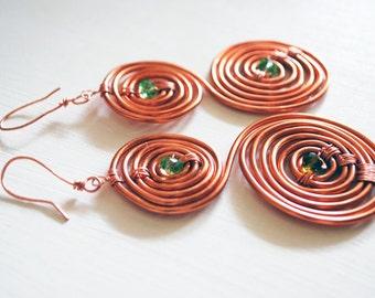 Copper spiral earrings, green crystal