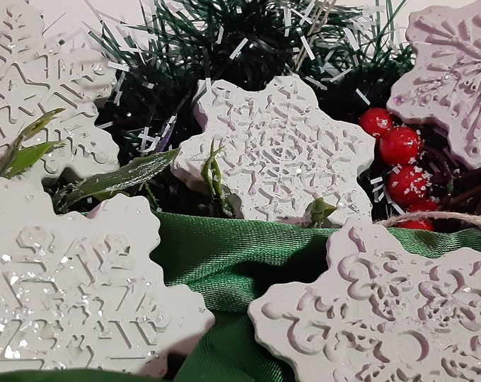 "Cement Snowflake Ornaments set of 6. Handmade. Glitter. 3"" wide by 1/4"" thick. Hemp string."
