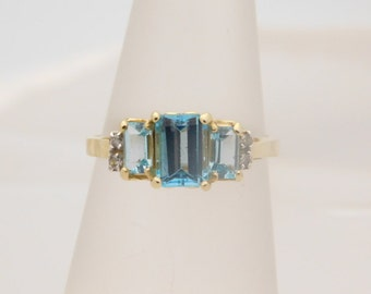 1.75 Carat T.G.W. Ladies Emerald Cut Blue Topaz & Diamond Ring 14K