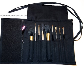 Pretty black Brush Roll With Zippered Pocket.
